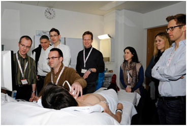 Hands-on echo session with a group of participants led by Prof. Felix C. Tanner from the University Heart Center Zurich (left).